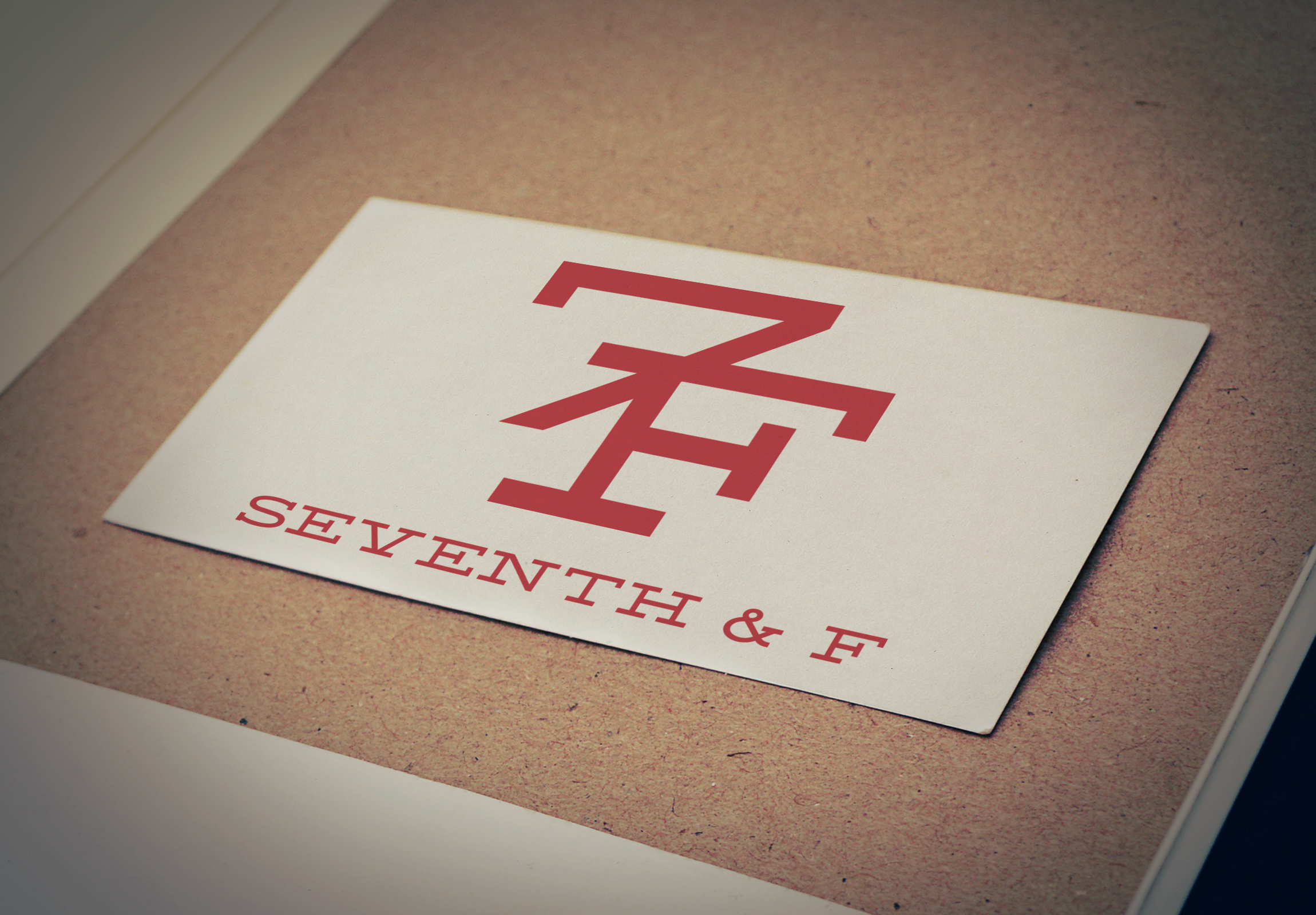 7th & F logo on a notecard pinned to a bulletin board