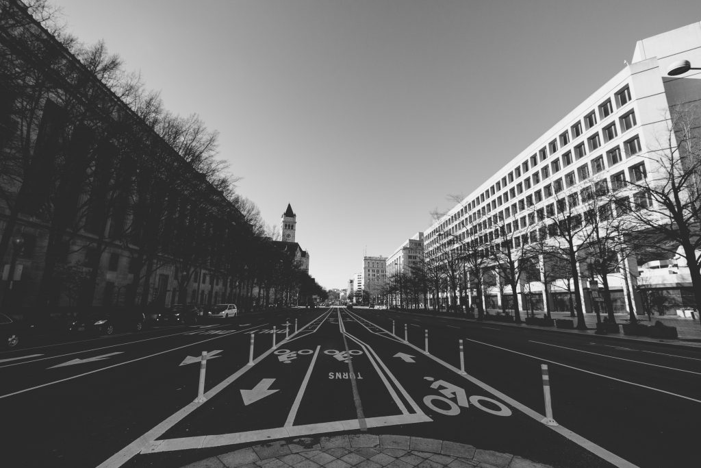 A photo of Pennsylvania Avenue in Washington, DC from the perspective of a pedestrian.